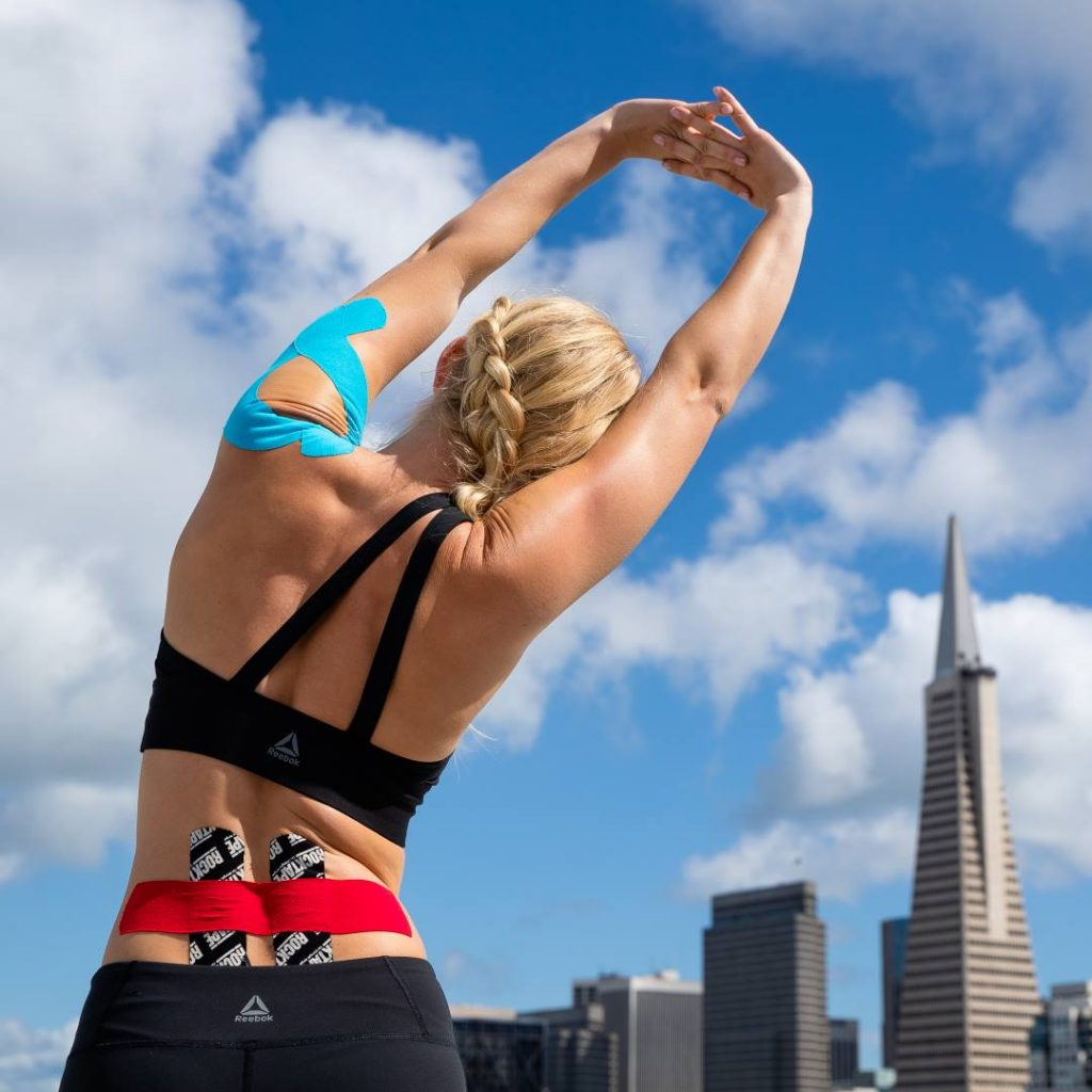 Woman Stretching Wearing RockTape Kinesiology Tape | Function 4 Life