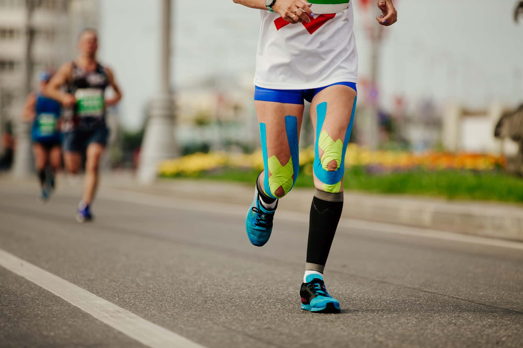 Runner Wearing Kinesiology Tape | Function 4 Life